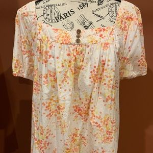 Short-sleeved breezy white top with orange flowers